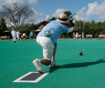 Chandler Eves delivers a bowl with impressive form at the Monora Lawn Bowling Club. Photo by Rosemary Hasner / Black Dog Creative Arts.