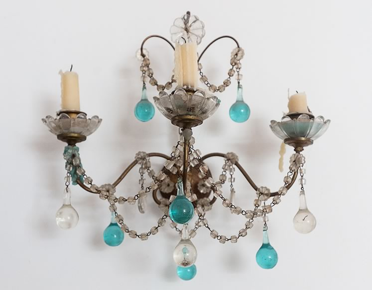 A candle wall sconce Jocelyn inherited from her great-aunt Margaret Hardy features teardrop blue crystals. Photo by Erin Fitzgibbon.