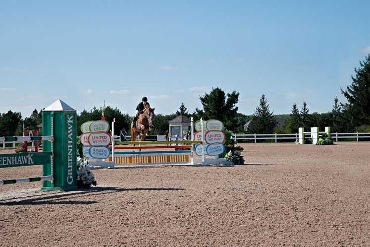 Annika Vels and Believe clear a jump in competition at Caledon Equestrian Park. Photo by Rosemary Hasner / Black Dog Creative Arts.