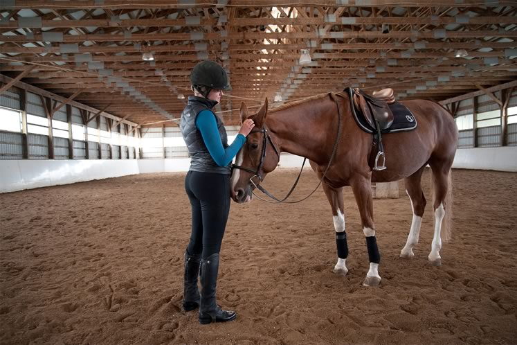 Annika Vels shares a quiet moment with Believe in the practice ring. Photo by Rosemary Hasner / Black Dog Creative Arts.