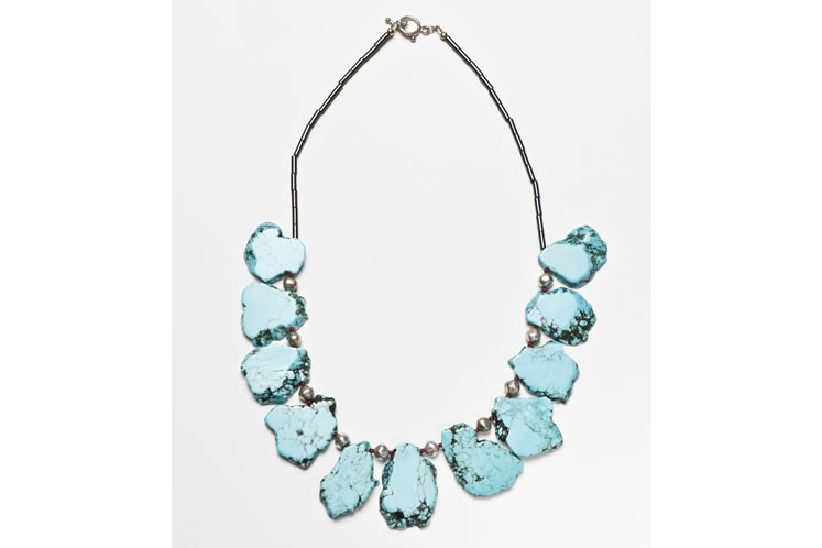 This Signature Collection necklace by Heidi von der Gathen features slabs of turquoise howlite with silver, coral and hematite accents and sells for $195. Photo by Pete Paterson.