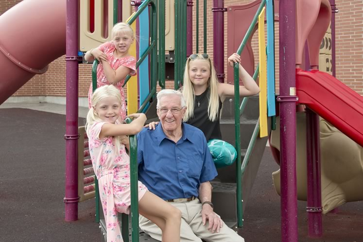"Bill Hayes, whom the kids call ""Mr. Bill,"" at Alton Public School with students Faith (rear), Ruby (left) and Brooke. Photo by Pete Paterson."