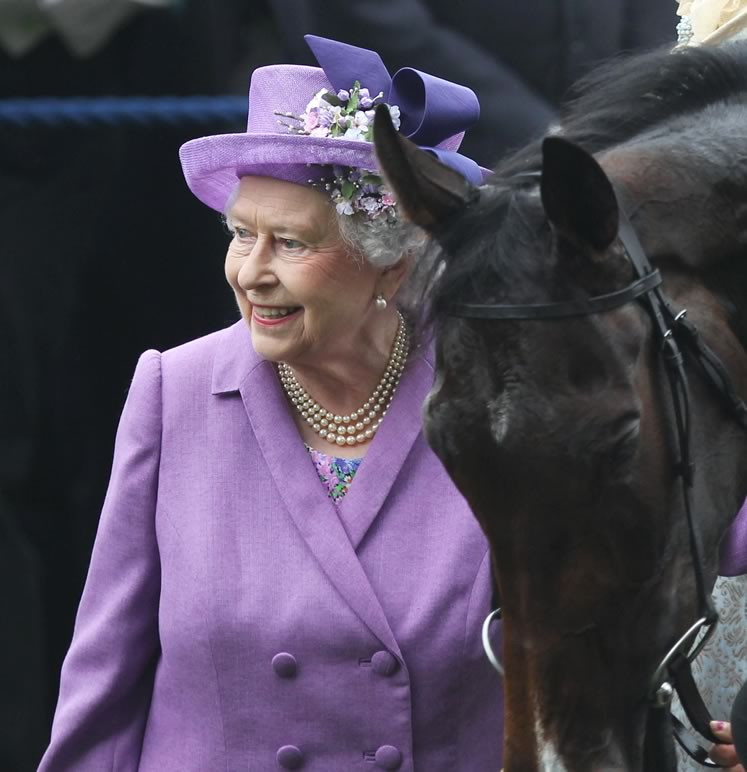 The Queen's race horse hobby has reportedly netted her about $9.4 million. Wenn Rights Ltd / Alamy Stock Photo.