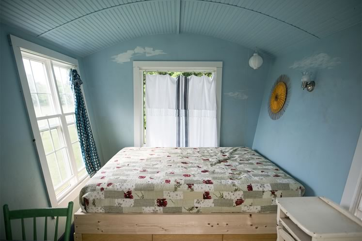 The cozy bedroom space inside the Riverdale caravan-on-wheels. Photo by James MacDonald.