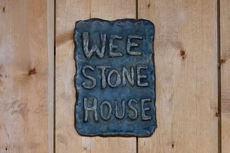 A hand-forged sign welcomes visitors to John Farrugia's tiny home. Photo by Rosemary Hasner / Black Dog Creative Arts.