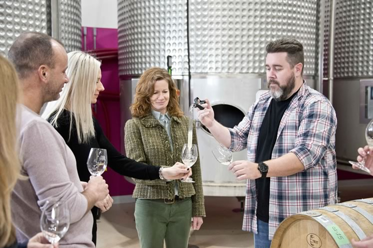 From left: Dino Florindi of Terra Cotta Inn, Heidi Baufeldt of Mrs. Mitchell's and Theresa Sauren of Mono Cliffs Inn sample wine with Windrush Estate Winery winemaker Jonathan Boyle. Photo by Pete Paterson.