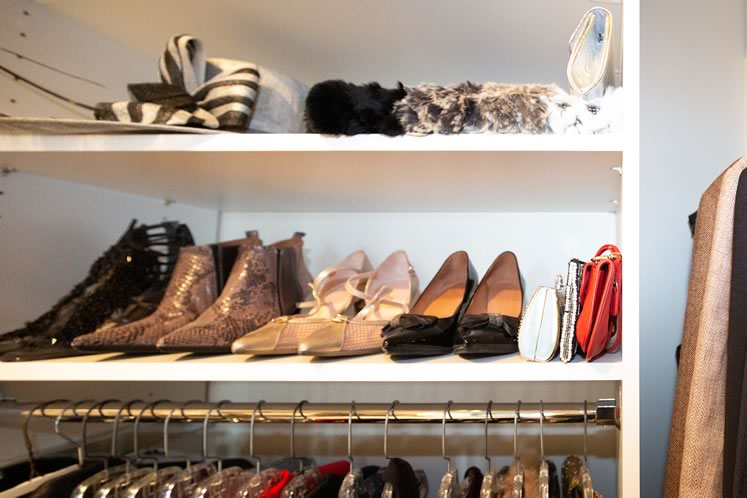 Every corner of Deb's walk-in closet is a reminder of her skill at fashion merchandising. Photo by Erin Fitzgibbon.