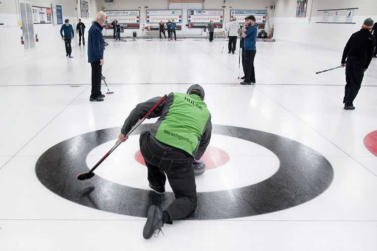 Jeff Hulse lines up a shot at the Orangeville Curling Rink. Photo by Rosemary Hasner / Black Dog Creative Arts.