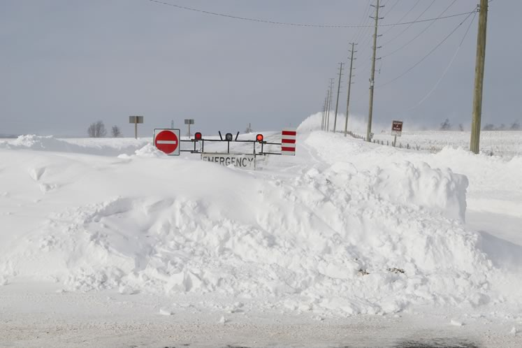 Emergency road closures are a common winter occurrence on many of Dufferin County's windswept roads. A blizzard in 2014 left many motorists stranded and in need of rescue. Photo by Steve Murphy.