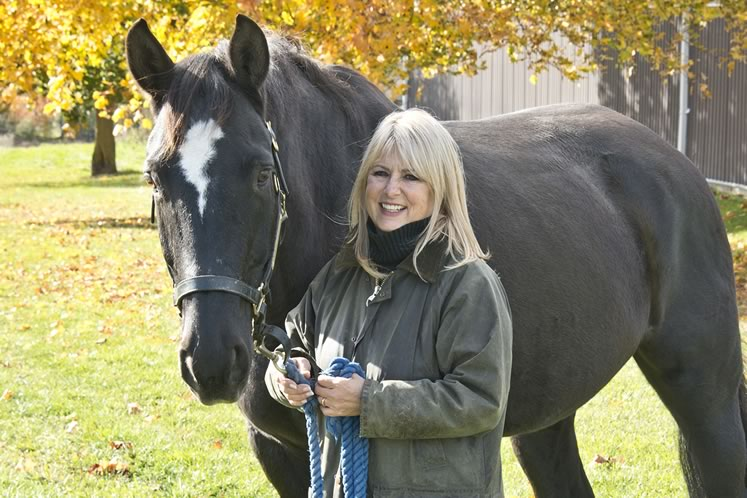 Ellen Downey (here with RCMP retiree Walsh) is the force behind the Youthdale Riding Program in Hockley Valley. Photo by Pete Paterson.