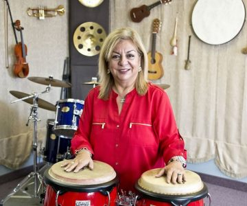 Mary Balinov makes music with heart at Tisho's Music Academy in Bolton. Photo by Pete Paterson.