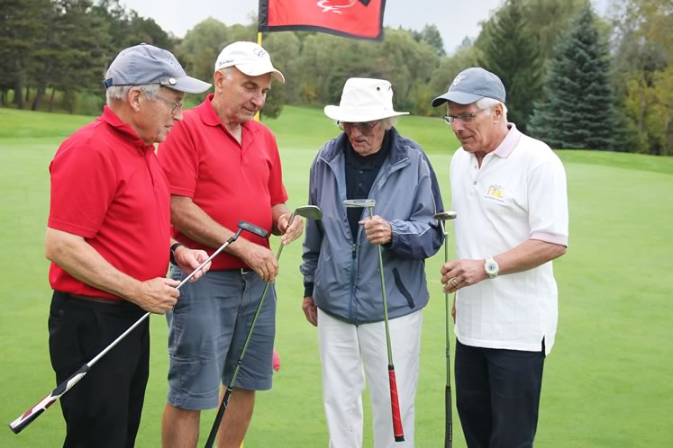 Bob Pillar (left), shown here with John Jelaca, Tony Oliver and Randy Freitag, organizes regular senior men's golf days. Photo by Enzo Villa.