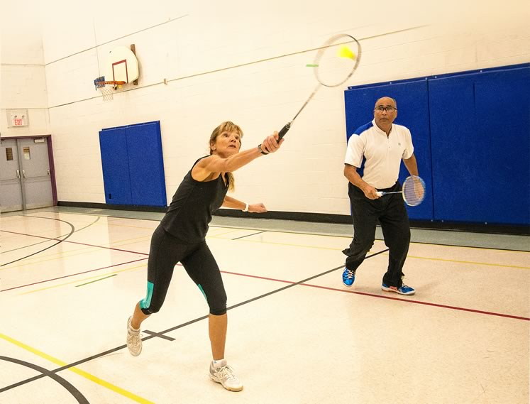 In an average 45-minute badminton match, a player covers four miles. Photo by Fred Webster.