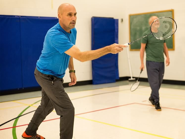 Long rallies are the norm for members of the Erin Adult Badminton Club. Photo by Fred Webster.