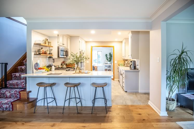The couple opened up the kitchen to the dining and living areas. Photo by Erin Fitzgibbon.