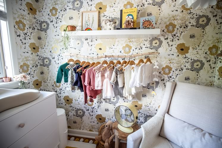 In Willow's nursery, a hanging branch does the work of a closet. Photo by Erin Fitzgibbon.
