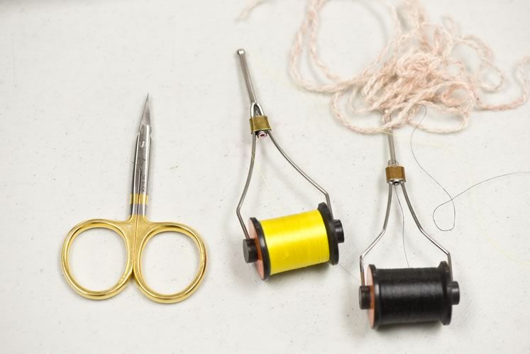 Tools of the trade include bobbins, wool yarn and scissors. Photo by Pete Paterson.