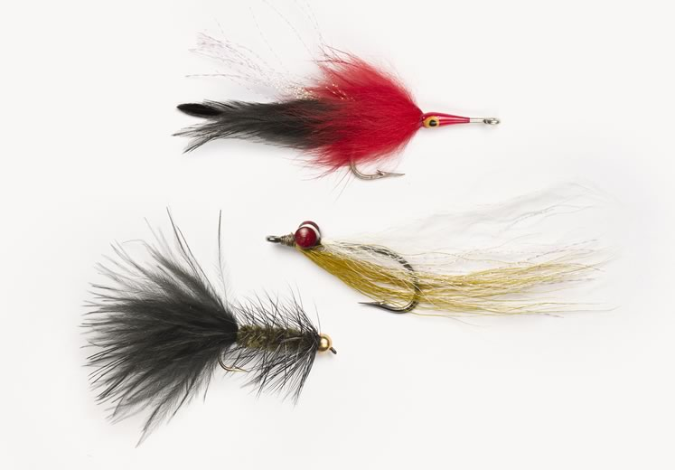 Fly fishing ties, from top: A tarpon fly, a Clouser Minnow and a Woolly Bugger. Photo by Pete Paterson.