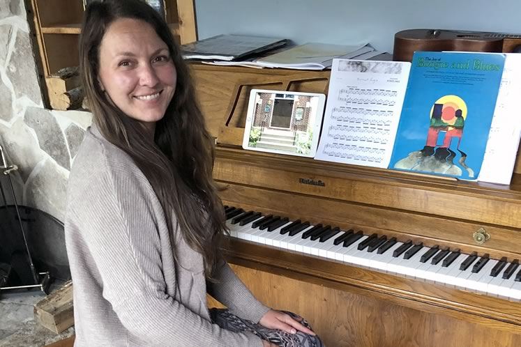 Grand Valley's Karla Leger teaches her piano students via video chats.