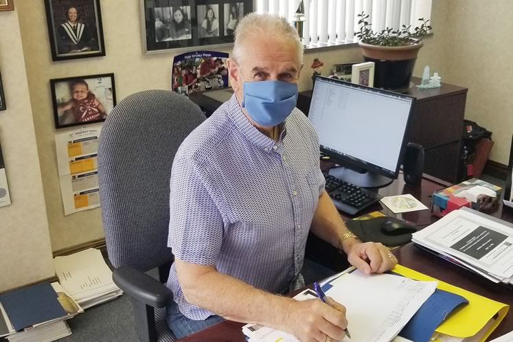 CEO Alain Baird of Stitch It wears a blue surgical mask his company has started making. His nephew, Bolton chiropractor Ryan French, bought and donated 1,000 of these masks to the Region of Peel. Photo courtesy Stitch It.