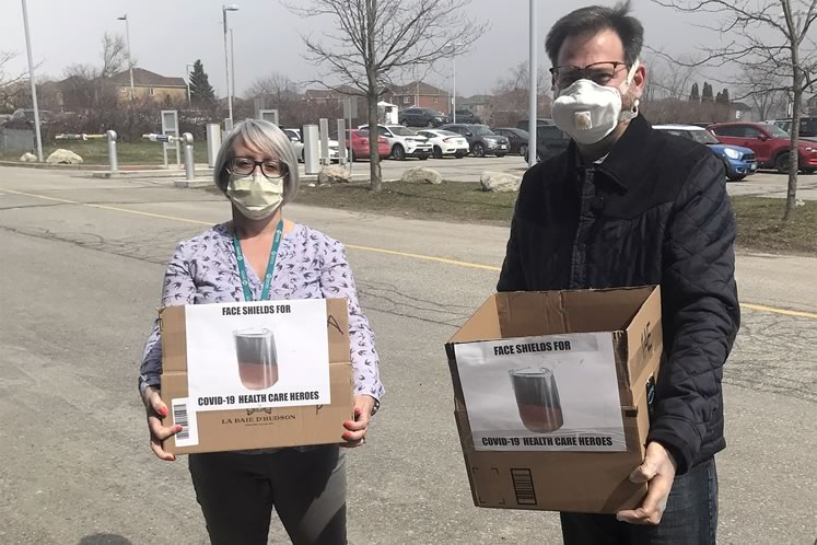 Felix Mueller of Triple M Tool & Mfg. (right) in Orangeville donated the face shields he and his brother Marcel made for workers at Headwaters Health Care Centre. The hospital's Sharon Henry co-ordinated the donation effort. Photo courtesy Headwaters Health Care Centre.