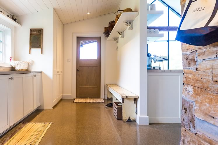 A sleek mudroom area off to the side of the new kitchen. Photo by Erin Fitzgibbon.