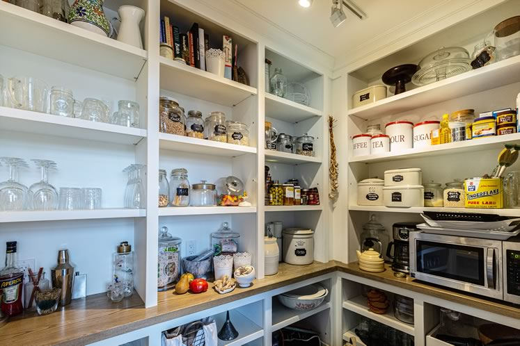 The new kitchen features an envy-inducing pantry area. Photo by Erin Fitzgibbon.