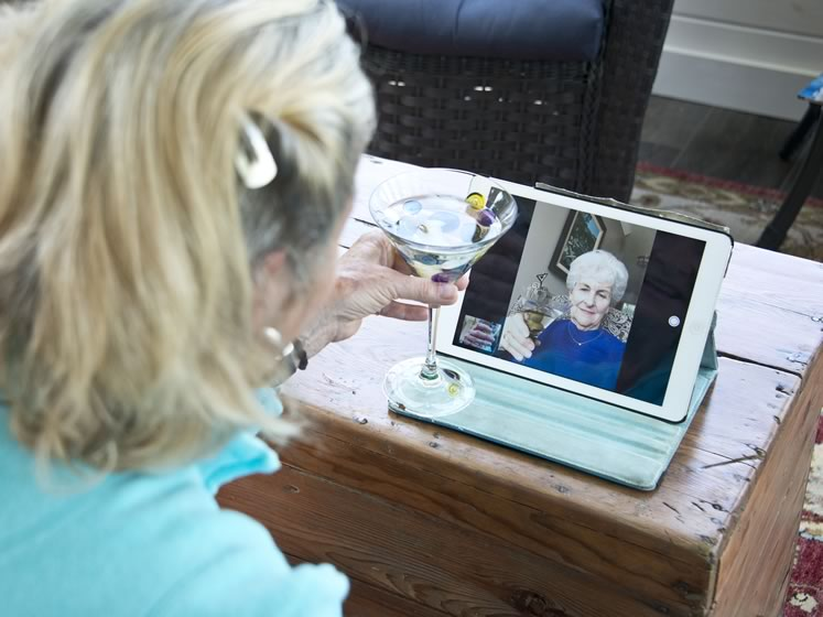 Quarantini with a twist: Writer Gail Grant settles in for a Skype chat with a distant friend. Photo by Pete Paterson.