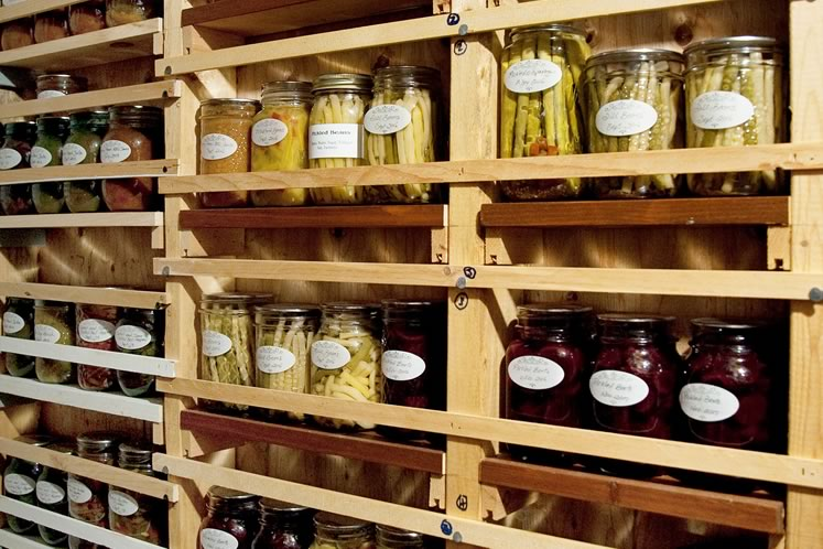 Karen stores her ample collection of preserves in a cold cellar. Photo by Rosemary Hasner / Black Dog Creative Arts.