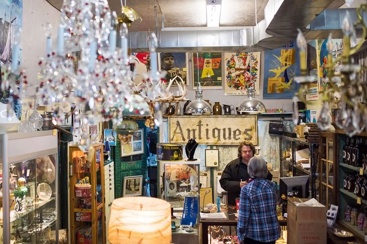 Jon Medley talks to a shopper at his large, packed-to-the-rafters heritage barn on Highway 10. Photo by James MacDonald.