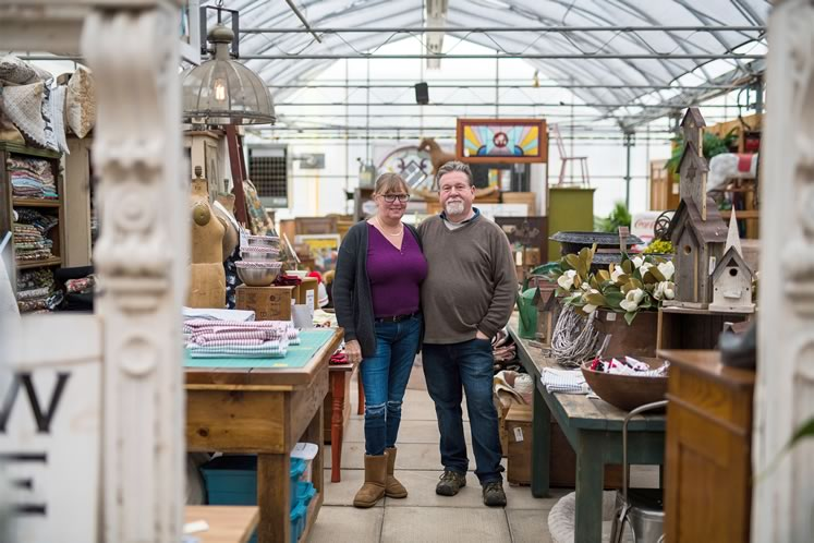 Joanne and Martin Woudenberg stand next to her sewing station amid the store's carefully curated antiques. Photo by James MacDonald.