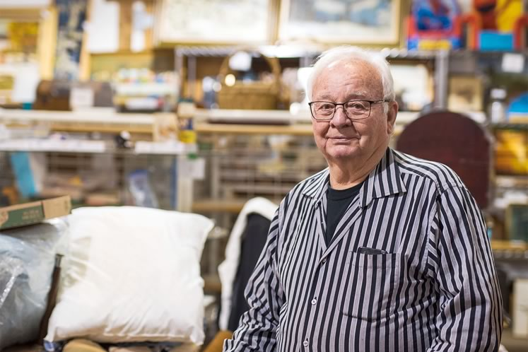 Don Reinhart, who joined his family's business in 1965, sits in the auction warehouse on Heart Lake Road. Photo by James MacDonald.