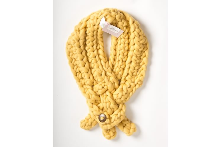 A yellow scarf is made with a quarter-weight version of the wool. Photo by Pete Paterson.