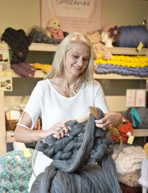 Svetlana Ponkin demonstrates knitting with supersized merino wool at the Rare Threads shop in the Alton Mill. Photo by Pete Paterson.