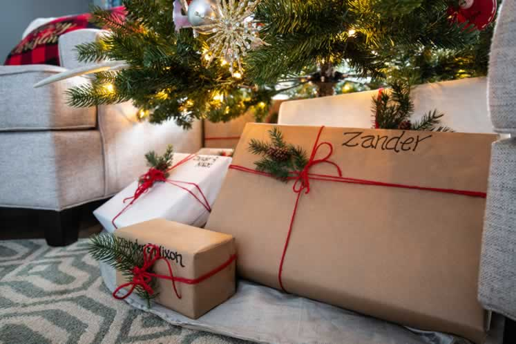 The family's Christmas gifts are wrapped simply and tied with red string. Photo by Erin Fitzgibbon.