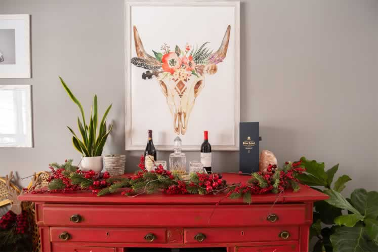 Jacelyn's most treasured piece is this vintage red sideboard. Photo by Erin Fitzgibbon.