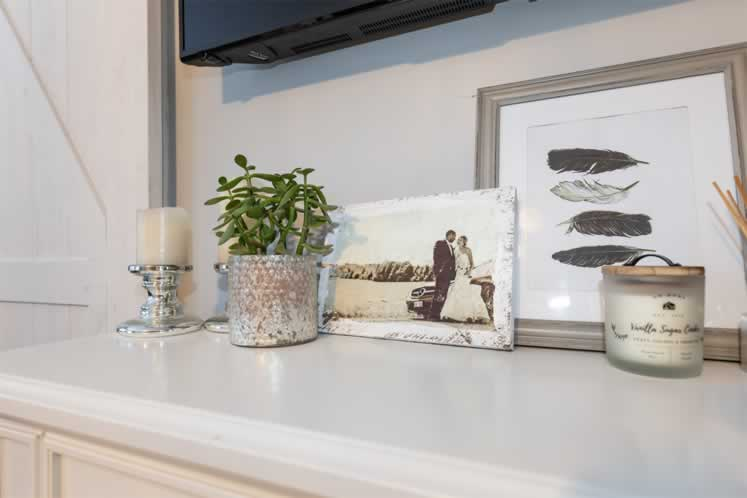 The calming principal bedroom features Shandor and Jacelyn's wedding photo on a dresser. Photo by Erin Fitzgibbon.