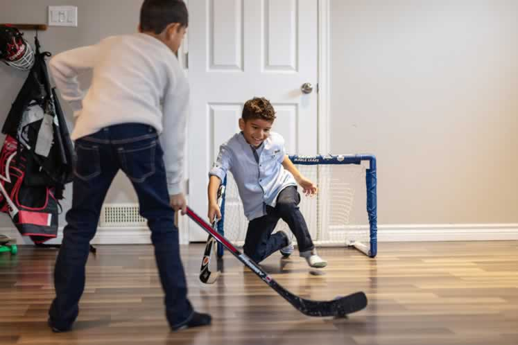 Zander and Nixon practise their hockey moves inside too. Photo by Erin Fitzgibbon.