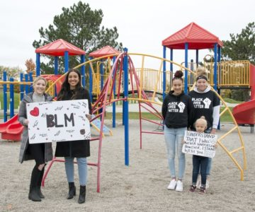 Hailey McLarty and Shyanne Wharton-Haines Ricci (left) organized the June 14 Shelburne Black Lives Matter march. Sisters Seanna (left) and Makenna Thomas (right), were behind the Orangeville march the same day and walked with little sister Emma. Photo by Pete Paterson.