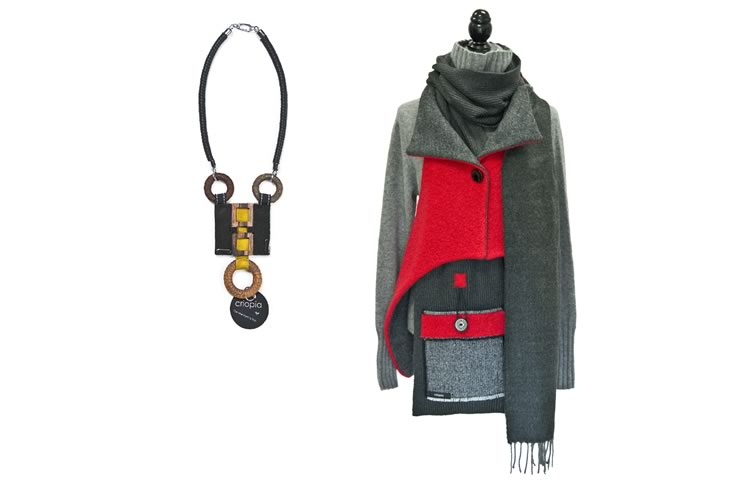 A geometric Criopia necklace and trademark outerwear in red and shades of grey. Photo by Pete Paterson.