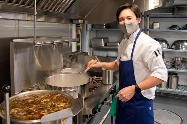 On the same level, head chef Shigetaka Wakai checks his stock pots in the prep kitchen. Photo by Pete Paterson.