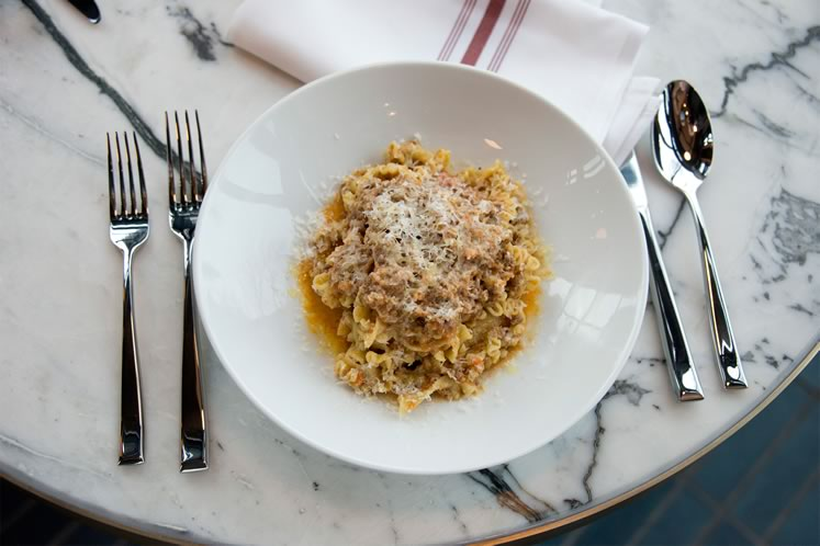 One of the specialties of the kitchen is handmade mafaldine topped with Bolognese and lots of Parmigiano Reggiano. Photo by Pete Paterson.