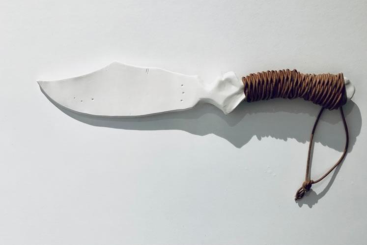 "Hush13½"" x 3""porcelain, leather ~ by Christine Nnawuchi"