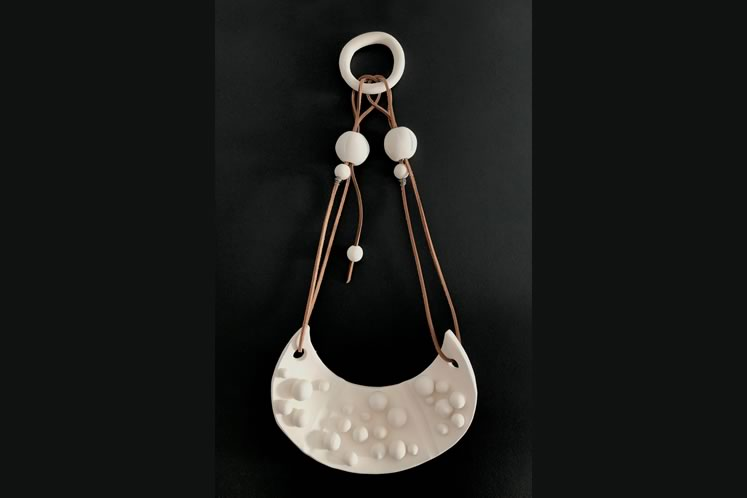 """Sacred Amulet9"""" x 22""""porcelain, leather, stainless steel ~ by Christine Nnawuchi"""