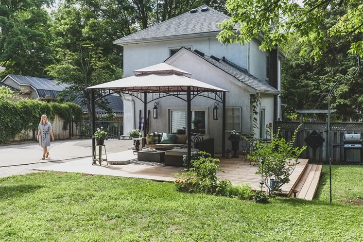 Mature trees and a steel gazebo provide a backyard oasis for the Grys family. Photo by Erin Fitzgibbon.