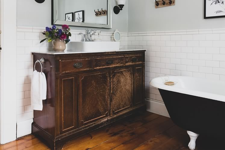 The vanity is made from an antique buffet. Photo by Erin Fitzgibbon.