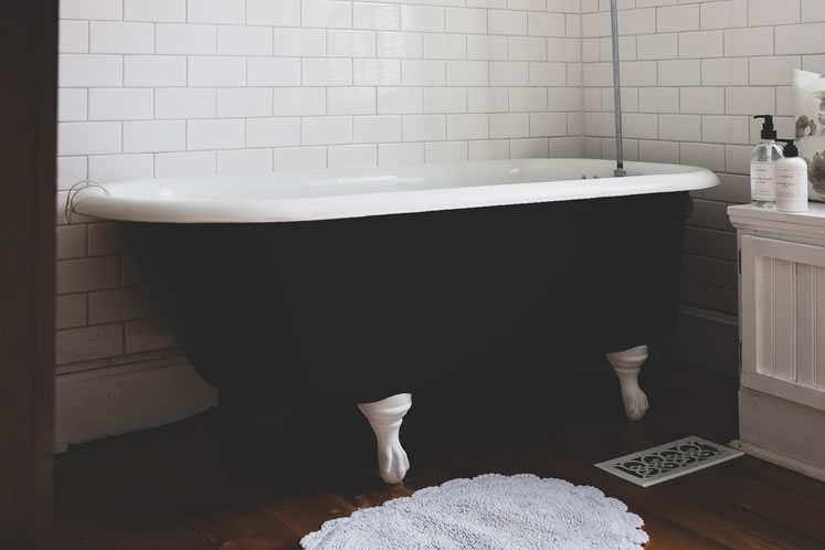 The clawfoot tub is the star of the bathroom. Photo by Erin Fitzgibbon.