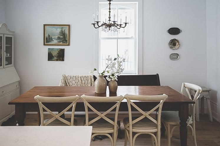 An antique harvest table dominates the dining area. Photo by Erin Fitzgibbon.