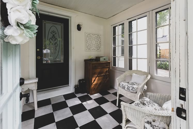 A checkerboard floor adds cheer to the home's porch. Photo by Erin Fitzgibbon.