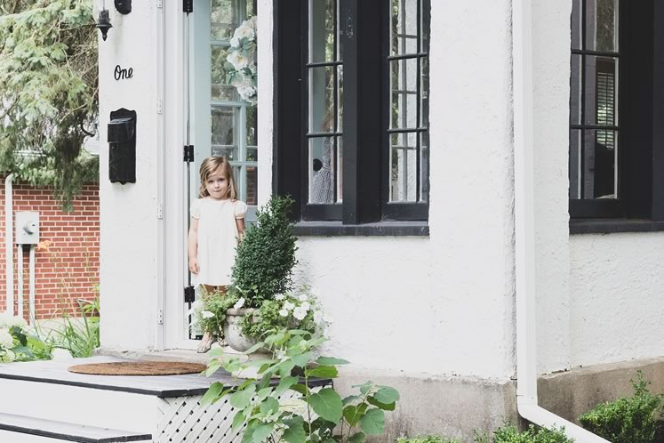 """Abby, on the steps of their """"modern farmhouse"""" in Erin. Photo by Erin Fitzgibbon."""